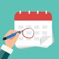 mao-com-calendario-de-marca-de-caneta_1325-126