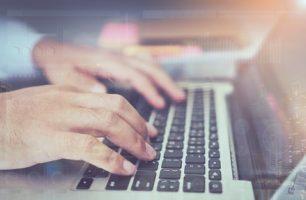 double-exposure-of-businessman-hand-working-laptop_2034-159
